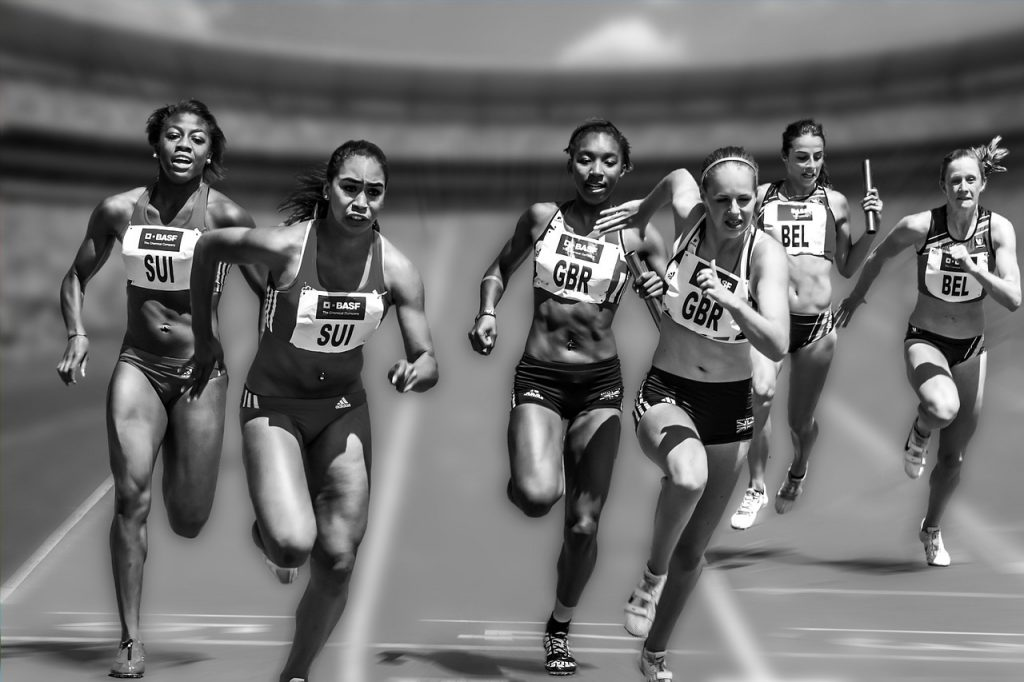 Women competing in a track meet