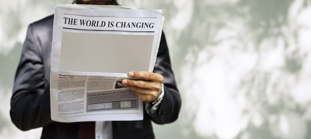 Reading a newspaper article about a changing world
