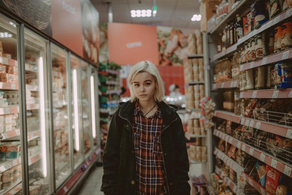Women in Frozen Foods at Grocery Store