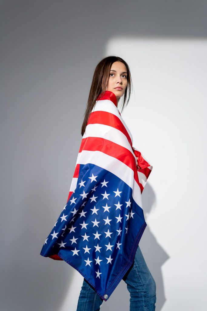 Woman wrapped in flag